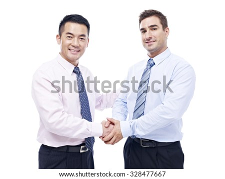 asian and caucasian businessmen shaking hands looking at camera smiling, isolated on white background. - stock photo