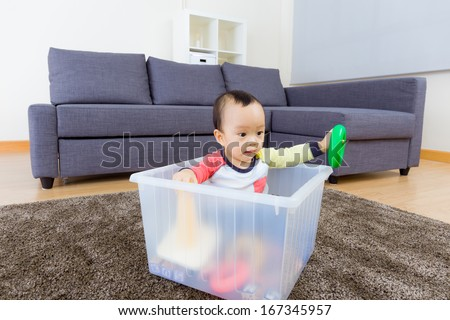 Asian baby boy playing at living room - stock photo