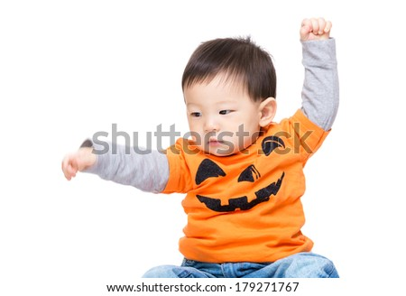 Asian baby boy with halloween dressing and hand up - stock photo