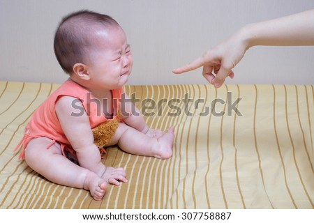 Asian baby crying while mother scolding  - stock photo