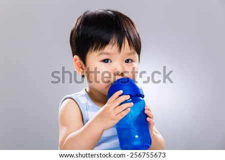 Asian baby drinking water - stock photo