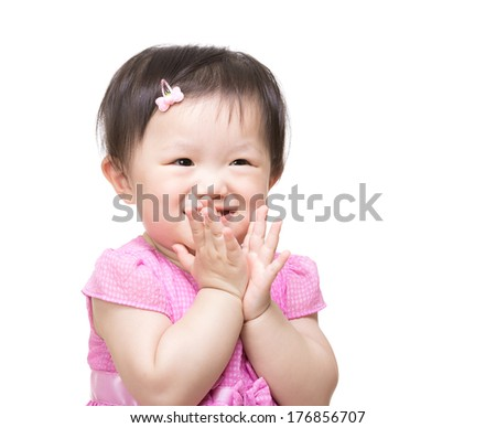 Asian baby girl clapping hand - stock photo