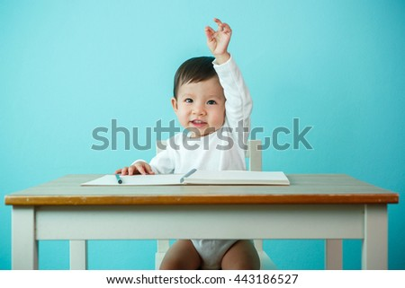 Asian baby girl Hand up at the school - stock photo