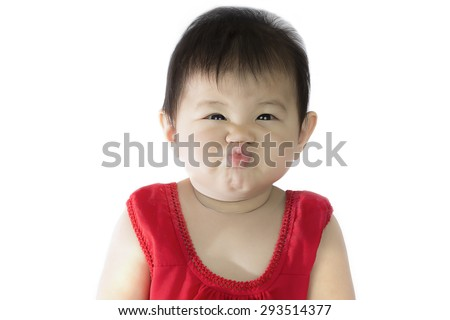 Asian baby girl happy facetious in red Thai suit isolate on white background. - stock photo