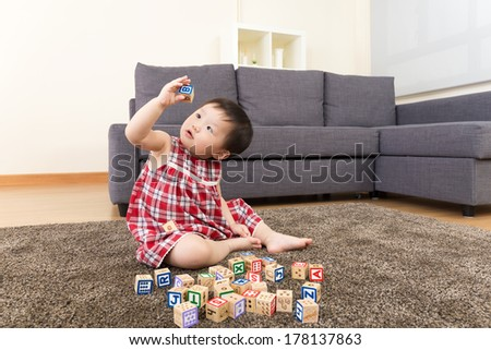Asian baby girl playing toy block - stock photo