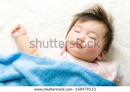 Asian baby girl sleeping - stock photo