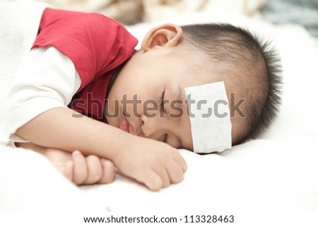 Asian baby sleeping and suffering fever heat - stock photo