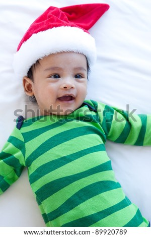 asian baby  with christmas hat - stock photo