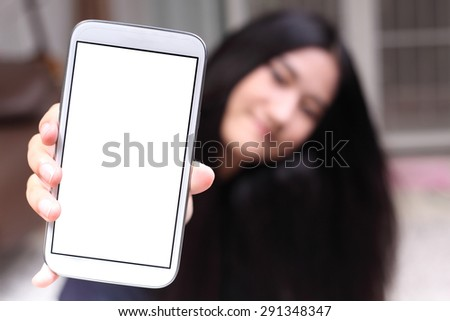 Asian beautiful girl smiling happy using a smartphone . Mixed race Asian Caucasian pretty model - stock photo