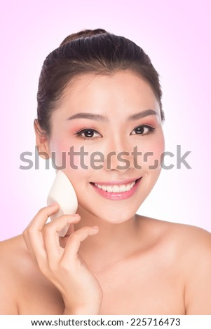 Asian beauty woman skin care close-up. Beautiful young woman touching her face looking to the side. Isolated on white background. Asian model. - stock photo