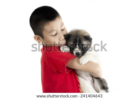 Asian boy and Thai Bangkaew puppy isolated on white. - stock photo