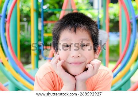 Asian boy enjon with outdoor playground - stock photo