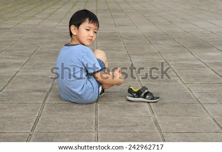 Asian boy hurt his leg - stock photo