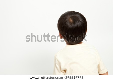 Asian boy kid interest in something like looking or staring at - stock photo