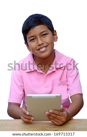 Asian boy playing with his tablet computer isolated on white background with clipping path. - stock photo