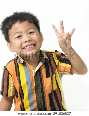 Asian Boy present sign language ,Hand sign Number Three - stock photo