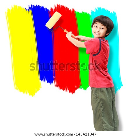 Asian boy use paint roller painting the wall - stock photo