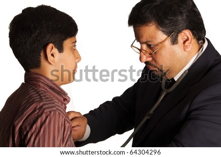 Asian Boy visiting the doctor for checkup - stock photo