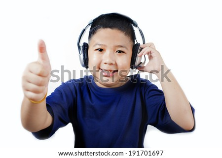 Asian boy with headphones listening to music. - stock photo