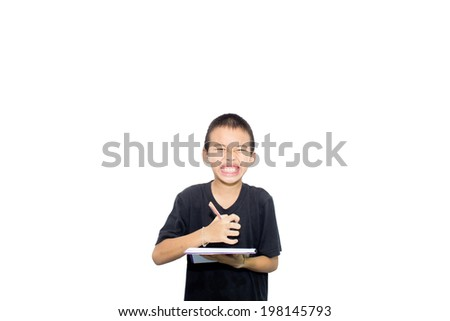 Asian boy with homework stress - stock photo