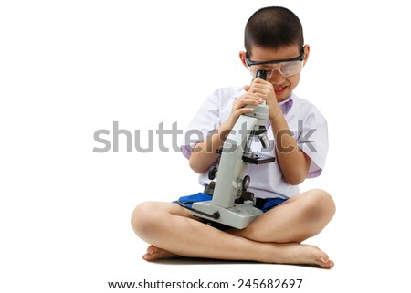 asian boy with microscope isolate on white clipping path - stock photo