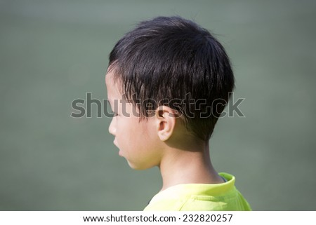 Asian boy with sweated hair after sport - stock photo