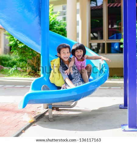 Asian brother and sister enjoy playground outdoor - stock photo