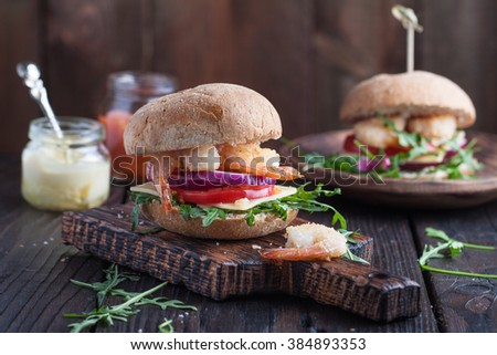 Asian burger with shrimps, arugula, cheese, tomato and onion with mustard sauce - stock photo
