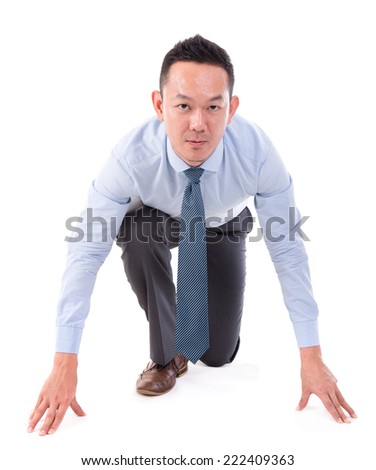 Asian business male on starting line of a race, front view full length isolated over white background. - stock photo