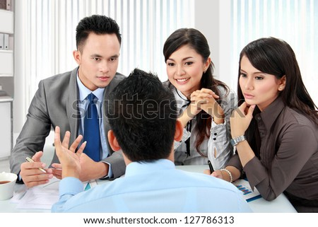 asian business man and woman meeting in the office - stock photo