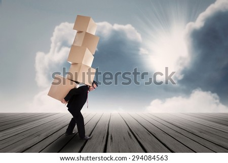 Asian business man carrying boxes - stock photo