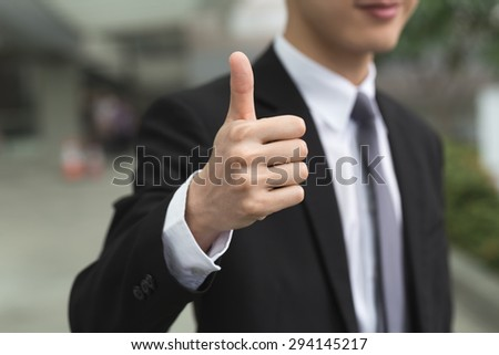 Asian business man give you a excellent gesture. - stock photo