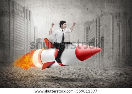 Asian business man riding rocket. Business achievement concept - stock photo
