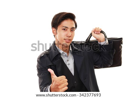 Asian business man showing thumbs up sign  - stock photo