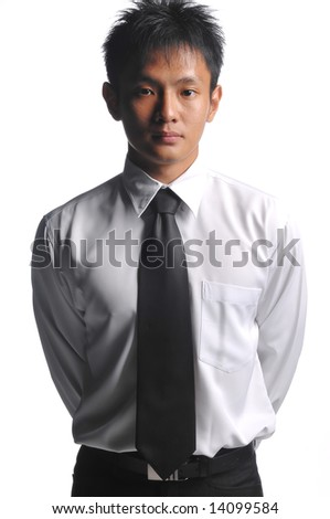 asian business man standing upright - stock photo