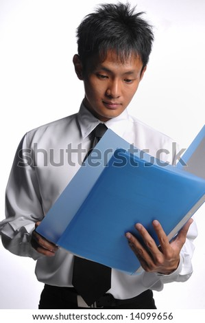 asian business man with file and handphone - stock photo