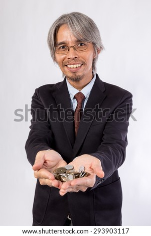 Asian Business man with Japan Coins in hands (yen) - stock photo
