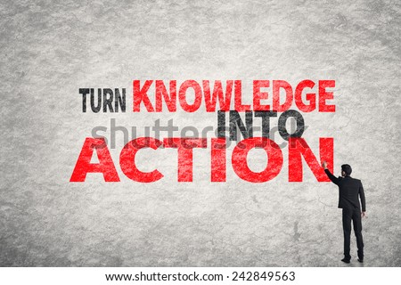 Asian business man write words on wall, Turn Knowledge Into Action - stock photo