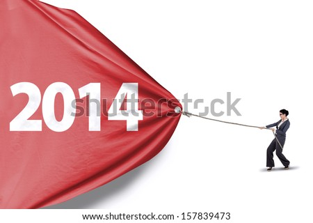Asian business manager is pulling big number of 2014 on white background - stock photo