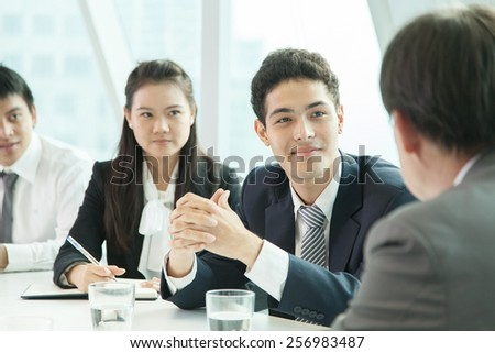 Asian business people discussing in the meeting room - stock photo