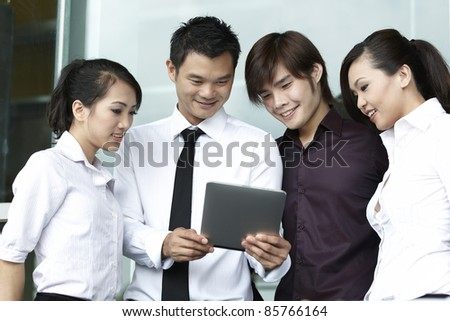 Asian business people using a Digital Tablet computer - stock photo