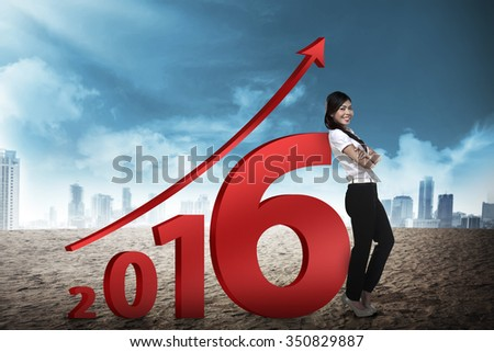 Asian business person lean next to 2016 number. New year resolution concept - stock photo
