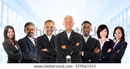 Asian business team in multiracial. Diversity business people form by different races, Indian, Malay, Indonesian, Chinese standing in office environment. - stock photo