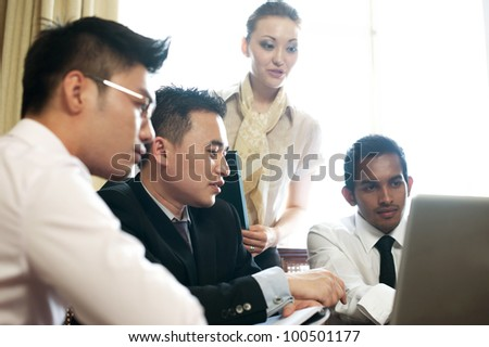 Asian Business Team in Room - stock photo