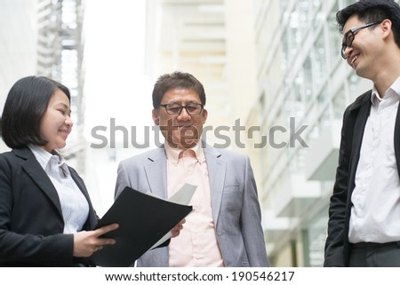 Asian business team meeting. Business executive presenting charts to CEO boss over office. - stock photo