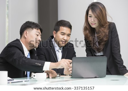 Asian business, technology and office concept - strict female boss talking to business team. - stock photo