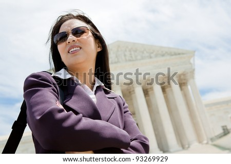 Asian business woman at Supreme Court in Washington DC - stock photo