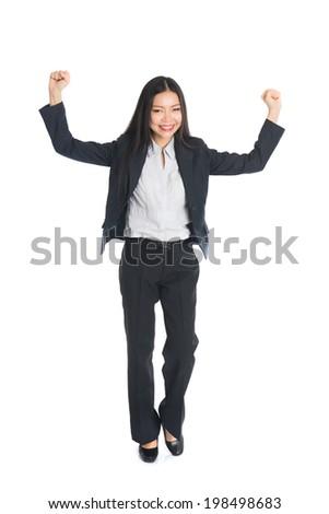 asian business woman celebrating success full body - stock photo