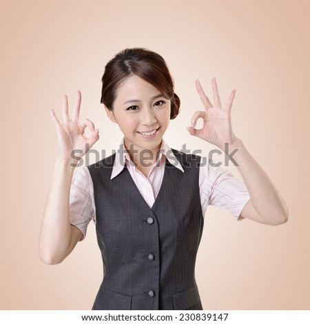 Asian business woman give you OK gesture, close up portrait with clipping path. - stock photo