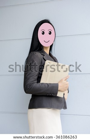 Asian business woman holding a laptop. - stock photo